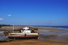 Left fishing boat on the coast of the Pacific Royalty Free Stock Photo