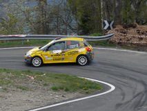 Left hairpin turn. Car number 32 facing an hairpin bend in Saint-Nicolas' stage of the 42nd Rally of Aosta Valley in 2012 on April the 27th/28th Royalty Free Stock Image
