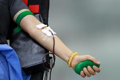 Left hand blood donation with rubber hand grip Royalty Free Stock Photos