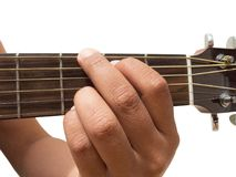 Left hand gesture `chord G` guitar chord finger position in close up isolated on white background. A male Left hand gesture `chord G` guitar chord finger Stock Photography