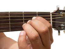 Left hand gesture `chord A` guitar chord finger position in close up isolated on white background. A male Left hand gesture `chord A` guitar chord finger Royalty Free Stock Images