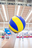Left hand holds a volleyball Royalty Free Stock Photography