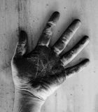 Left hand of a man dirty of charcoal Stock Photo