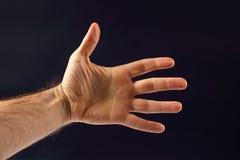 Left hand men on a dark background. The left hand men on a dark background Stock Photography