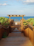 Enter Tropical Paradise Vacation. A peaceful and secure wooden gated view of the ocean Stock Photos