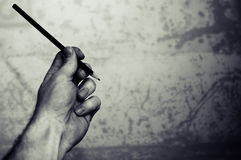 A Left hand with a pencil Stock Photos