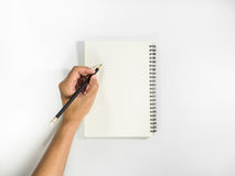 Left hand with pencil prepare to writting on notebook. Top view stock photography