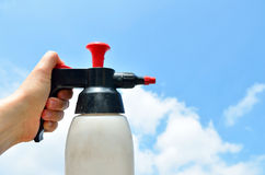 Spray bottle in the left hand Stock Photography