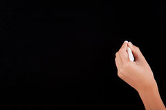 Left Hand writing on a blackboard Stock Images