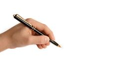Left handed child writing on white paper royalty free stock photo