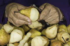 Left-handed peeling cooking-pears Stock Photo