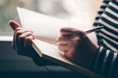 Free Left-handed Woman Writing Diary Royalty Free Stock Photos - 148161478