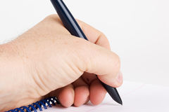 Left handed writing Stock Images