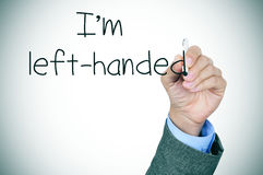 Left-handed writting the text I am left-handed Stock Images