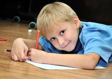 Left-hander boy is drawing Royalty Free Stock Photo