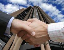Left-handshake in the street royalty free stock photos