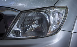The left headlight of automobile. Royalty Free Stock Image