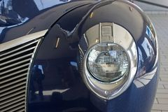 Only left headlight shown of a 1940 blue Mercury stock photos