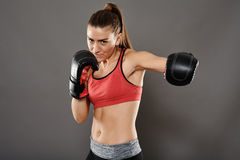 Left hook from kickbox girl. Left hook punch from young kicbox woman Stock Photography