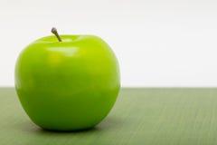 Apple on Table Macro Stock Image
