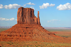 Left Mitten Rock Formation - Monument Valley. Left Mitten Rock Formation under a blue sky with billowy white cumulus clouds - Monument Valley, Arizona Royalty Free Stock Images