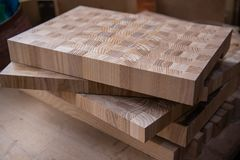 Left-over pieces of plywood stacked in carpenter`s workshop stock image