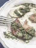 Left overs of mozzarella salad with pesto sauce Stock Photo