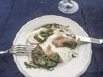 Left overs of mozzarella salad with pesto sauce Stock Photos