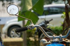 Left rear mirror and hand bar with brake system of vintage Japan. Ese motorcycle royalty free stock photo