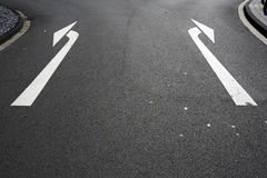 Left or right. Left and right arrows on road Royalty Free Stock Image