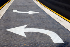 Left or Right?. A middle turn lane made of brick painted dark gray. Brexit? Obamacare? Reform royalty free stock image