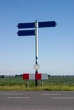 Left or right?. Empty road sign, two directions, isolated against a clear blue sky Stock Photography
