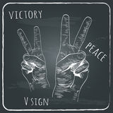 Left and right hands with victory sign. Royalty Free Stock Images