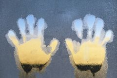 Left and Right Hand-prints on the frozen ice window royalty free stock photography