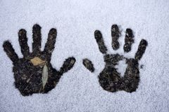 Left and right human prints in the snow. royalty free stock photos