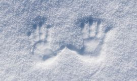 Left and right human prints in the snow. Royalty Free Stock Images