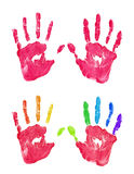 Left and right kids red color and rainbow handprint set isolated on white background Royalty Free Stock Photo