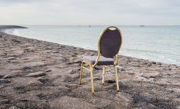 Left seat on a tarmac pier at the sea Royalty Free Stock Photos
