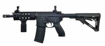 Left side AR15 SBR with 30rd mag and extended collapsible stock. Black AR15 SBR with 30rd magazine, extended collapsible stock, fwd pistol grip and iron sights Royalty Free Stock Photo