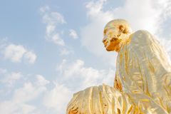 Left side of asian monk statue Royalty Free Stock Photos