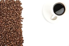 Left side frame of coffee beans with coffee cup Royalty Free Stock Photo