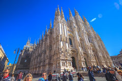 Left side Milan Dome. Milan, Italy - March 7, 2017: left side of Famous Milano Dome cathedral in Piazza Duomo square. Tourists walking and shopping in fashion royalty free stock images