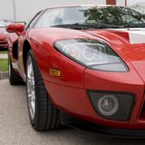 Left Side - Red Sports Car. Left side of a parked, bright red sports car stock images