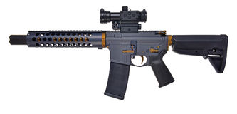 Left side SBR AR15 / M16 with collapsible stock, 10` barrel with large muzzle device. Left side view SBR AR15 / M16 with extended collapsible stock, Optics, 30rd Stock Photography