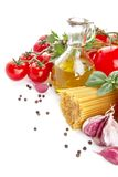 Left side shot of pasta with tomatoes,basil,oil,garlic on white Royalty Free Stock Image