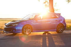 Left side view of blue sport car Stock Photography
