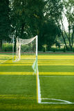 Left side view of standard goal and net in football pitch or soccer field, sport equipment in the stadium Royalty Free Stock Images