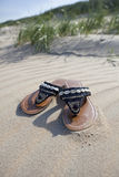 Left slippers on the beach Royalty Free Stock Images