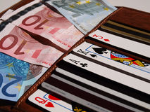 Left to chance. Card wallet containing playing cards among credit cards and euro bank notes Stock Photography