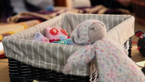 Left to right pan shot over table with knitting products stock video